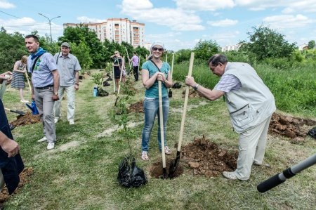 Young planting trees for a new park in Vladimir, R...