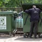 Poor man searching in garbage, Vologda, Russia...