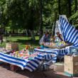 Trade stall with various stuff in park, Russia...