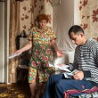 Russian family with legal documents at their apart...
