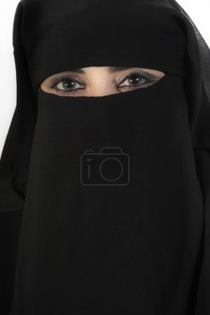 Photo for Portrait of a middle eastern woman wearing a black hijab - Royalty Free Image