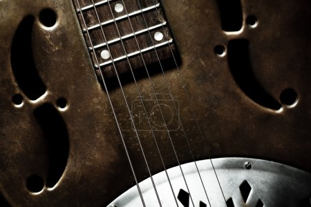 Photo for Color shot of an old vintage guitar - Royalty Free Image