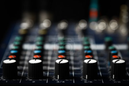 Photo for Detail of a music mixer desk with various knobs - Royalty Free Image