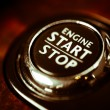 Detail on the start button in a car...