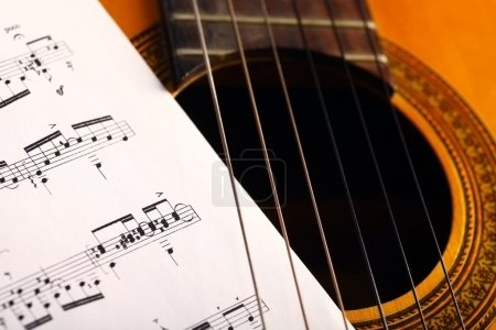 Photo for A classical guitar and a music sheet. - Royalty Free Image