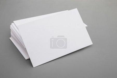 blank business cards stack up on grey background