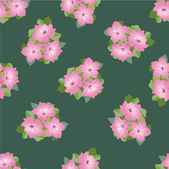 Pink flowers petunia on green background