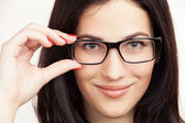 Eyewear glasses woman closeup portrait. Beautiful Brunette Girl