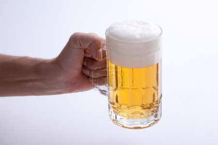 Beer poured into a mug