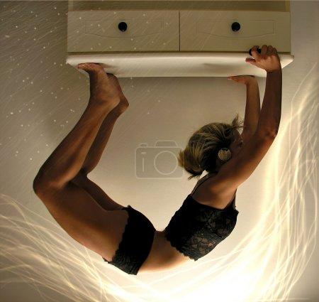 Girl doing upside down bridge.