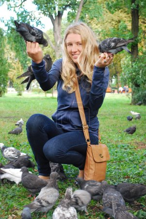 the park, the girl feeding pigeons