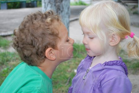 So kiss me! The little girl wants to kiss a boy.