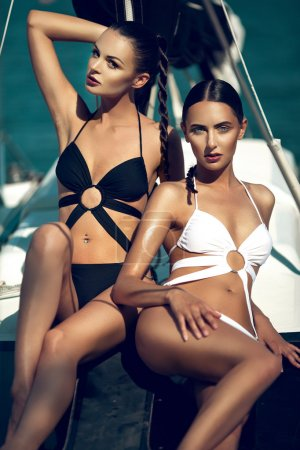 Two beautiful girl on the yacht
