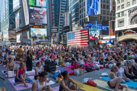 Thousands of New Yorkers practicing yoga in Times Square.