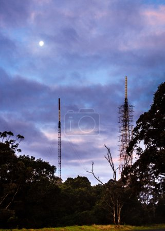 Phone masts in nature under a full moon