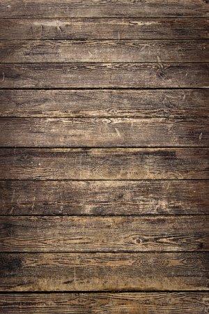 Photo pour L'arrière-plan de vieilles planches de bois brun usé - image libre de droit