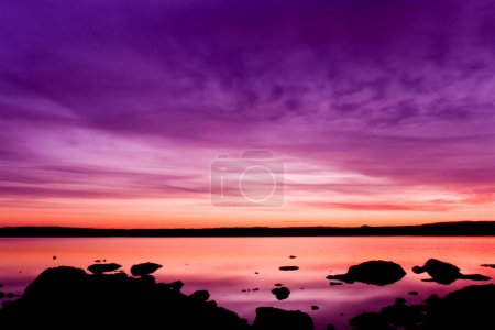 Purple sunset over sea water