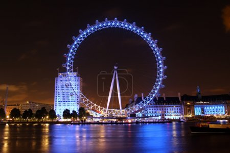 Photo for The London Eye is a giant Ferris wheel situated on the banks of the River Thames in London, England. The entire structure is 135 metres tall and the wheel has a diameter of 120 metres. - Royalty Free Image