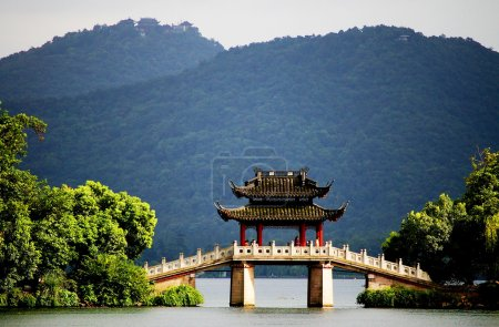 a pavilion bridge in west lake, hangzhou, china