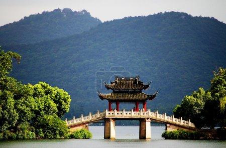 A pavilion bridge in west lake, hangzhou, china