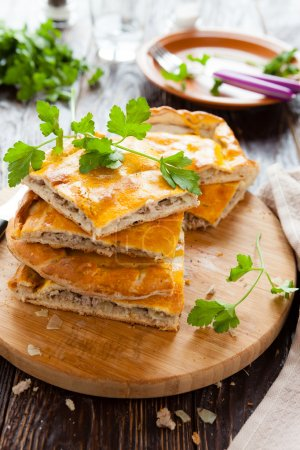 Photo for Tasty meat pie pieces and parsley, closeup - Royalty Free Image
