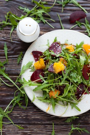 Photo for Salad with fresh greens and beets, top view - Royalty Free Image
