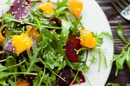 fresh green salad with arugula and beets