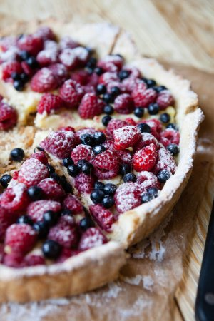 delicious blueberry pie with raspberries