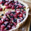 Delicious blueberry pie with raspberries, food clo...