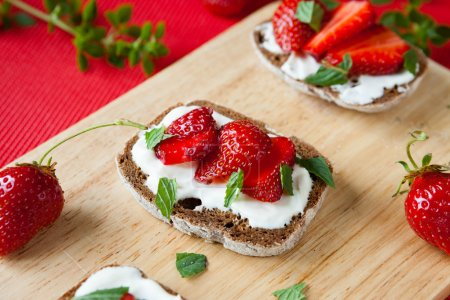 Photo for Bruschetta with strawberries and cheese, close up - Royalty Free Image