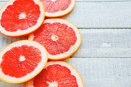 Photo for Ripe grapefruit on white boards, food closeup - Royalty Free Image
