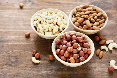 Photo for Three kinds of nuts in a bowl, food closeup - Royalty Free Image