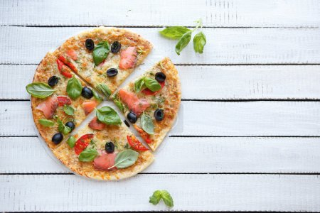 pizza with cheese, smoked salmon and olives