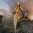 Image of a wheeled excavator on a quarry tip...
