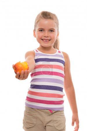 Little girl offers a nectarine