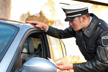Police officer checking driving license