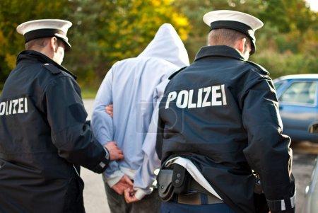 Police officers arrest man