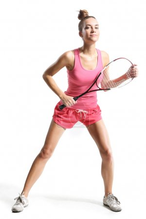Photo for Beautiful athletic woman with squash racket - Royalty Free Image