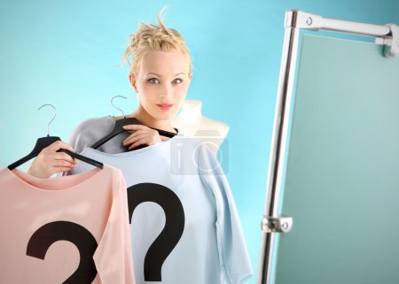 Photo for Woman shopping wonders blue or pink blouse - Royalty Free Image