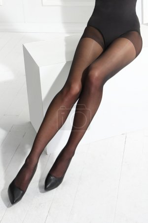 Sexy female legs in black tights