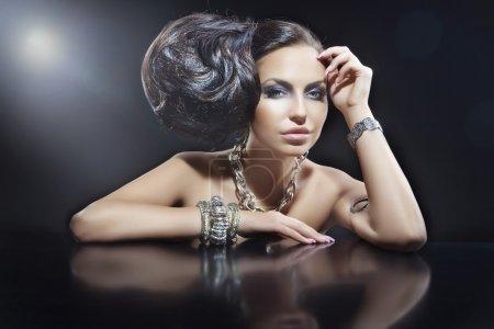 Portrait of beautiful brunette woman wearing jewellery