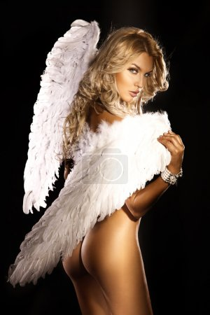 Beautiful naked blonde angel looking at camera.