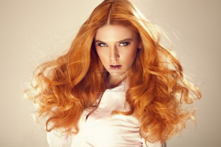 Portrait of red hair beautiful woman, looking at c...