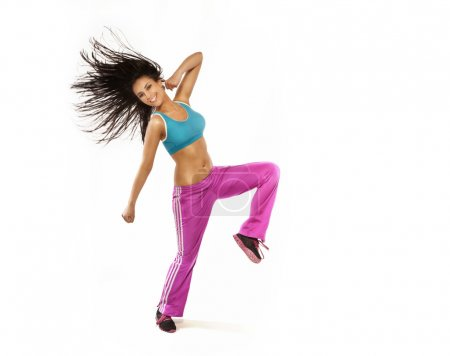 Brunette smiling woman with perfect fitness shape jumping and sm
