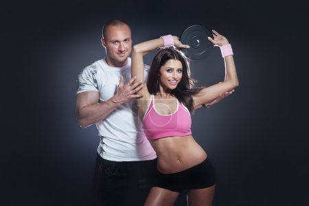 Beautiful athletic couple posing and training.