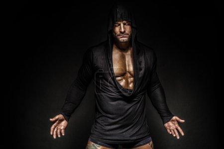 Portrait of man in hood.