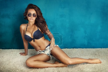 Photo for Summer photo of beautiful brunette woman posing in sunglasses and wearing swimsuit. - Royalty Free Image