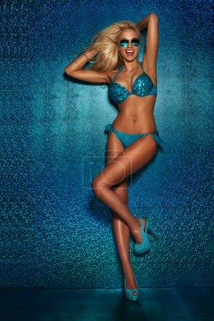 Sexy blonde woman posing.