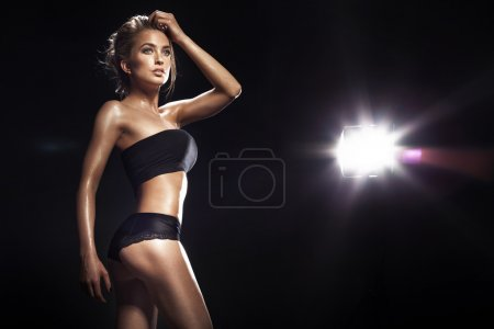Photo for Sensual blonde woman posing in black sensual lingerie . Studio shot - Royalty Free Image