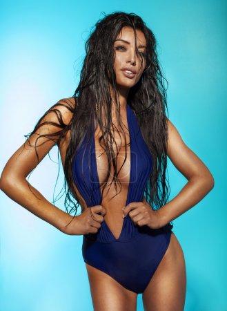 Sexy brunette lady posing in swimwear